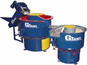 This photo shows two round bowl vibratory systems being used in series.  An automated part feeder meters in parts.  After processing in an initial operation, parts can be separated and then transferred to either a secondary finishing operation or dried.  Photo courtesy of Giant Finishing Inc.