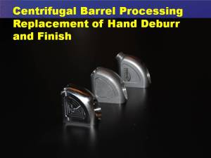 Machining and milling marks apparent on the front medical device have been completely removed by centrifugal barrel finishing